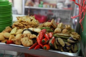 A variety of fried veggies and chilies.