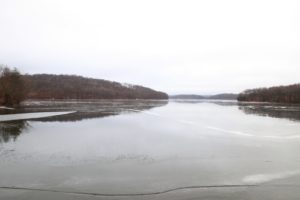 This is the nearby Cross River Reservoir - Its frozen surface has been covered with of the newly fallen rain.