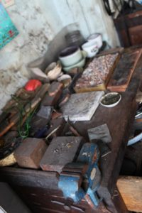 This is the work desk of the owner of a small jeweler's shop that Sophie found.