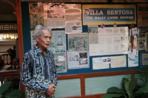 This is the owner of the Villa Sentosa, who is proud of the amount of press his villa had gotten over the years.