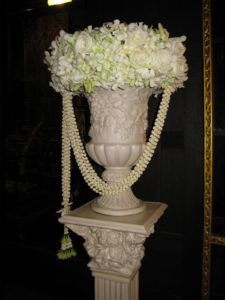 Amazing white urns flanked the doorways.