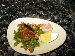 A first course of winged beans, shrimp, and egg with chilies and fried garlic