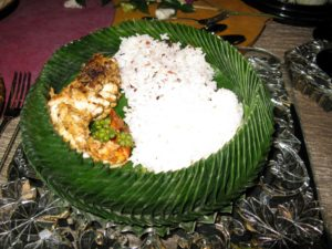 The banana leaf bowl was filled with lobster, fragrant rice, and plain rice.