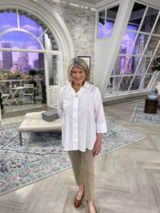Here I am on one of the many QVC sets wearing my Stretch Poplin/Chambray Button Front 3/4 Sleeve Hi-Low Hem Blouse and my Stretch Twill Pull-On Ankle Pants with Step Hem - the perfect outfit for this mild spring-like day.