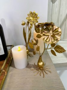 These are my Decorative Metal Flowers. They come in sets of three with a gold-tone. They are replicas of old Italian metalwork. These are so pretty in any room in your home. I also shared my flameless candles from Luminara. These come in 2-inch, 4-inch and 6-inch pillars in spring pink or neutral.