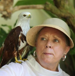 Because of her hat brim, Memrie can't see that an eagle is now on her shoulder.