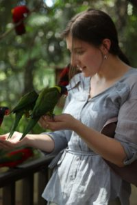Sophie conversing with green parrots