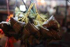 We loved these bamboo leaf-wrapped dumplings filled with rice and meat.  They are packed with partially cooked ingredients and then steamed for hours.