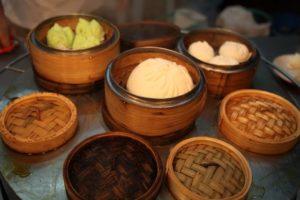 Steamer baskets with dumplings and pau - steamed buns