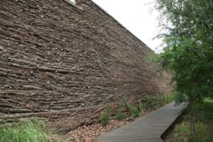 A mud and sandstone wall along the entryway to the Lebombo Lodge.