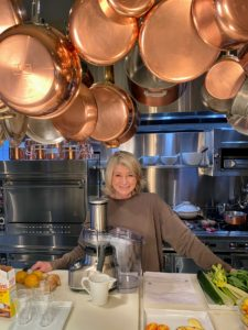"""This is my Winter House kitchen. Above me is a giant pot rack where I display lots of my copper pots. If you've seen any of my recent """"Homeschool with Martha"""" tips on my Instagram page @MarthaStewart48, you've likely seen me working at this counter."""