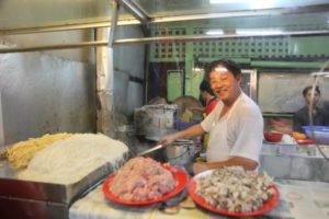 Another friendly chef busy at work on Petaling Street