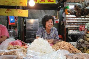 This kind lady sells bamboo leaf-wrapped dumplings and other traditional snacks.