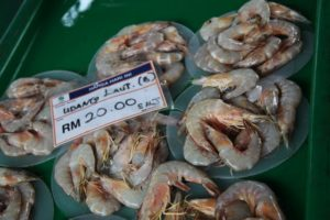 The prawns are sold with head on.