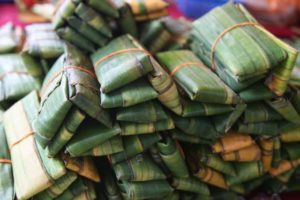 This is a stack of fish cakes wrapped in bamboo leaves.