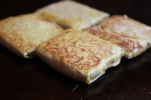 A close up of the murtabak filled with egg - The skin is the same as the famous Roti Canai and can be replaced by Popiah Skin Wrapper - Chinese Spring Roll Wrapper.