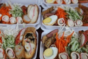 Wonderful little lunch boxes - seafood, hard boiled egg, and vegetables