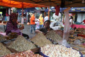 Shallots, garlic, and piles of dried fish
