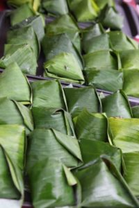 These banana leaves are filled with savory rice, meat, and more.