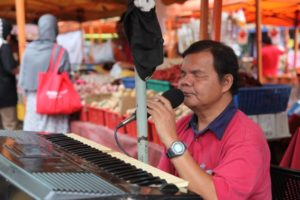 This man, who is blind, sings and plays piano at the market every week.  He has a very pleasing voice.