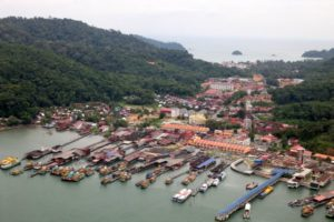 Not far by helicopter from Pangkor Laut Island is a small fishing town.