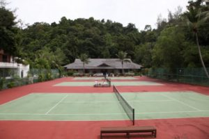 The tennis courts at the resort are beautiful.