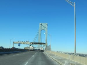 The Verrazano Narrows Bridge was built between 1959 and 1964 connecting the borough of Staten Island to Brooklyn at the Narrows.  It is 13,700 feet long, the largest suspension bridge in the world at the time of its completion.