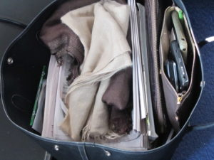 A view of one of my two carry ons - I use a 'wheelie' for cosmetics and electronics, and a hand bag for paper work, Blackberry, iPhone, cell phone, warm wraps, socks and important travel documents.