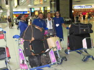 These very pleasant ladies of South African Airways greeted us upon arrival and helped guide us to the waiting cars.  We brought too much luggage, but we were trying to anticipate the weather, and the difference in city and safari life.  By the way, the luggage here is for the three of us!