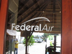 The airlines is called Federal Air.  They have a very pleasant waiting area and a charming shop and restaurant.