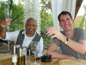 Ravi Naidoo, our host at Design Indaba and Kevin, toasting our arrival at Singita.  Ravi had to fly right back to Capetown to get on with preparations for the week-long conference on design for better living.