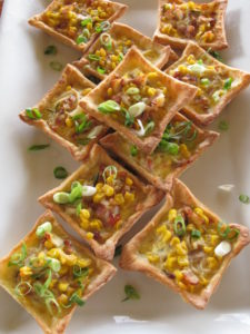 At high tea we were served these delicate tarts filled with corn, green onions, and tomato.