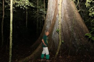 Adlin standing near a giant tree