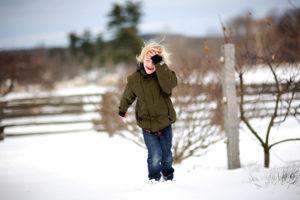 Harper getting walloped by a snowball - all in good fun.  Photo credit:  Raymond Haddad http://www.flickr.com/photos/raymondhaddad/
