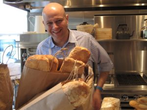 A happy Pierre next to the fresh ciabatta bread used for the box  lunches