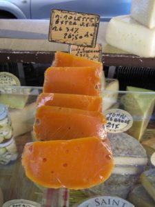 The first cheese I ever had in France was mimolette, a hard orange cow's milk cheese similar to a smooth Edam. Louis XIV requested this cheese to be made because he wanted a French cheese to resemble the Dutch one.