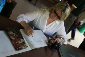Here I am signing their guest book.