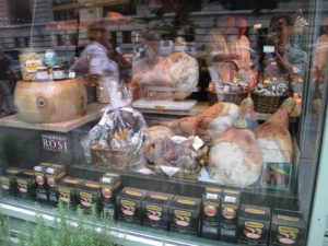 On one side of the restaurant, home cured hams, pork, salamis, and homemade condiments are for sale.