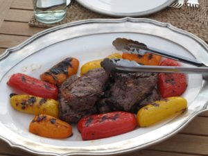 Wonderful bison steaks and roasted red, yellow, and orange peppers