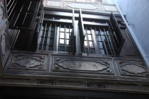 A closeup of the intricately carved woodwork