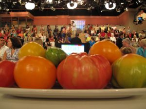 Very colorful heirloom tomatoes and a very colorful audience