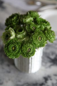 A new form of ranunculus - green - looked good in one of the many silver basket containers I placed on my dining table.