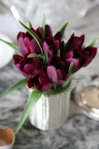 Deep purple tulips on the table