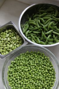 Fava beans, peas, and sugar snap peas all ready to cook
