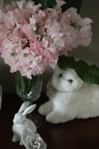 One table was decorated with bunnies.  The stuffed toy bunny from Jamali and the porcelain bunny from the Martha Stewart Collection at Macy's.  The wonderfully fragrant pink sweet peas  were arranged with some leather leaf ferns.