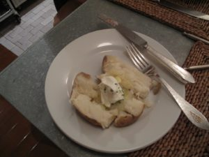 I love my potato with butter and sour cream and chives.