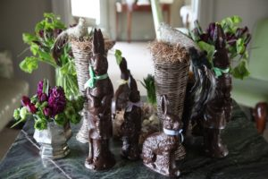 Chocolate bunnies, glittered birds, and flowers