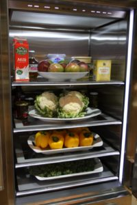 All of the refrigerated ingredients for each day's cooking segments are neatly arranged.
