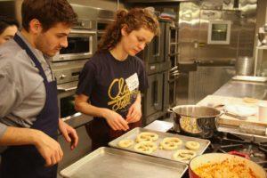 Thomas Joseph, studio chef - and Lina Kulchinsky, of Sigmund Pretzel Shop - preparing her pretzels for her segment with Martha.