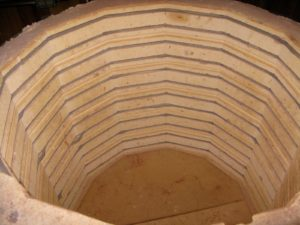The insides are lined with electric coils, providing the high temperatures necessary for firing pottery.